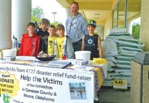 The Banana Bricks Robotics Team from Carman-Ainsworth's Randels Elementary spent last weekend at VG's collecting cans and bottles to help tornado victims locally and in Oklahoma.