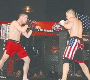 Mitch Rheaume (right) squares off with CJ Walker at a previous Kombat Promotions event.