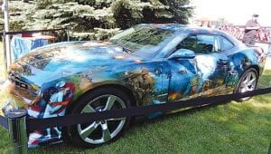 The American Pride Camaro, painted by airbrush artist Mickey Harris, was on display.