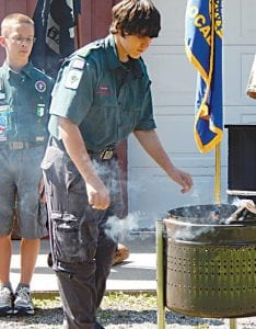 Boy Scouts of America Troop 368 from Grand Blanc demonstrated the proper way to burn and dispose of the American flag.
