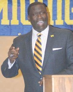 University of Michigan men's basketball assistant coach Bacari Alexander addresses the crowd.