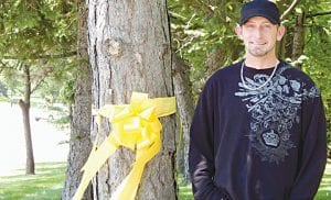 Passersby curious about yellow ribbons tied around three trees in front of a home on Lennon Road between Miller and Linden roads, need wonder no more. They were put up by resident Chad Hardacre in honor of his Army buddy Randy Carr who returned home last Thursday from Afghanistan. Hardacre came home himself in 2010 from Iraq and is a 1996 graduate of Carman-Ainsworth High School. He met Carr while both were stationed in Ft. Hood Texas. Hardacre plans to leave the ribbons up until Carr, who lives in Florida, takes them down himself during a visit scheduled next month. Hardacre said the yellow ribbons also pay homage to all his brothers and sisters serving in the military. Yellow ribbons are a long-standing symbol of support for the troops.