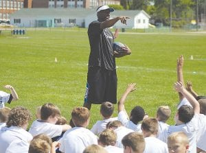 Detroit Lions' cornerback Chris Greenwood takes questions from the youngsters as the first day of the youth camp winds down.
