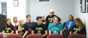 Members of Da Peeps robotics team with their coach and supporters received special recognition at a recent school board meeting.