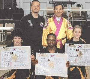 Left to right: (rear) Kenneth Wright, head instructor at Kuk Sool Won - Martial Arts, stands with Hyuk Suh; (front) Neil Mitchell, Jazaris Arrington and Mariah Guye-Wright.