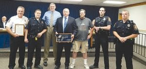 Members of the township police department joined Chief George Sippert and the township board in a retirement ceremony for Sgt. Randy Kimes (center).