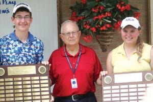 Ben Zyber (left) and Kristen Wolfe receive their plaques from FJGA supervisor Bill Hense.