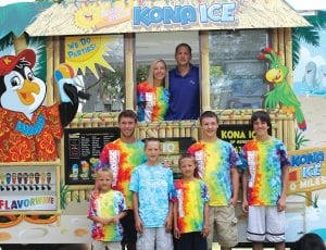 Dave and Mindy Griwatsch, back, with their family and employees of their burgeoning Kona Ice business. Family and employees include: from left to right, (middle) Logan Chapel, Blake Griwatsch, Tyler Bencheck, (front) Bowden Griwatsch, Brecken Griwatsch and Bronsen Griwatsch.