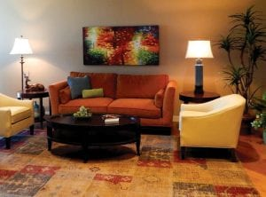 This colorful sitting room is one of several public rooms throughout the three-story home where guests can relax, wait for rides or use for small support group meetings.