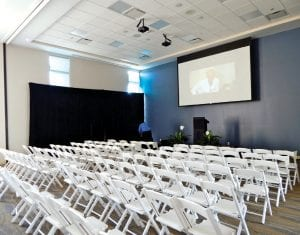 A Conference Wing features this large auditoriums that can seat up to 108 or be split into smaller rooms. It is equipped with audio/visual equipment for small or large meetings or movie nights. It also has a prep room for small catering needs. The auditorium was used to seat guests for the grand opening program. It has a separate outside entrance to safeguard the privacy of house guests when they arrive in a few weeks.