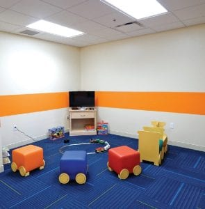"A Children's Playroom provides an inviting space designed for younger guests and is next door to a family-oriented game room. A fitness room, laundry area, private mailboxes, arts and crafts room, library and resident manager apartment are among many other house amenities designed to fulfill the mission of creating ""a home away from home'' for guests."