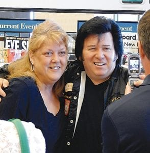 ELVIS FAN CLUB — Elvis Aaron Presley Jr., who says he is the son of the late singing legend of the same name, stopped by Barnes & Noble bookstore Monday to meet and greet fans. He signed copies of his CDs, posed for pictures and made small talk about his music with fans who came to see him. Several told him they were also planning to attend his schedule performance Tuesday night at the Clio Amphitheater.
