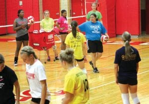 Swartz Creek volleyball coach Nellie Guajardo (blue shirt) directs the camp.
