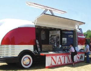 1940 GM Futurliner with side open for presentation.