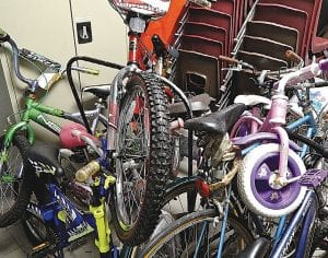 A small pile of donated bikes are accumulating in a storage closet at Baker College-Flint waiting for the start of a grant-funded Bicycle Repair project to be given to Carman-Ainsworth students whose families can't afford to buy one.