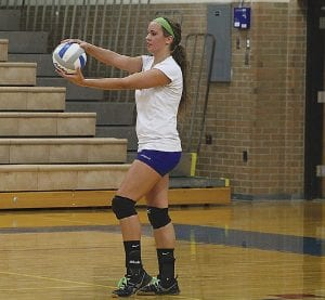 Carman-Ainsworth's Jessica Smith prepares to serve against Durand.