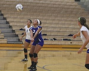 Carman-Ainsworth's Kali Jackson digs a ball to the front line Tuesday at Kearsley.