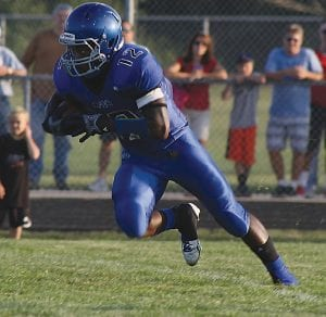 Carman-Ainsworth's Demarion Allen sprints down field during a kickoff return.