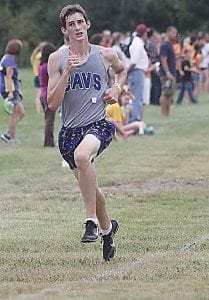 Carman-Ainsworth's Tyler Pangerl sprints for the finish line.