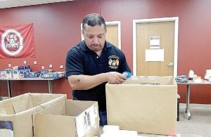 George Botello, a U.S. Marine Corps veteran who served in Iraq, gives back by helping pack care boxes for servicemen and women during a National Day of Service and Remembrance hosted by Davenport University on Sept. 11.