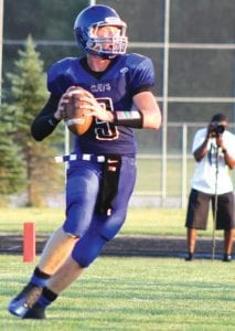 Carman-Ainsworth's Connor Storms rolls out against Grand Blanc during week one.