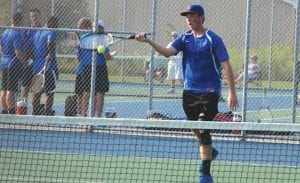 Carman-Ainsworth's Noah Reed returns a forehand at the Lapeer East Quad