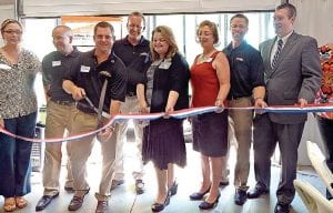 Servpro management cuts ribbons with help from representatives of the Flint-Genesee Chamber of Commerce and the Swartz Creek Chamber of Commerce, Flint Township Supervisor Karyn Miller and Flint Mayor Dayne Walling.