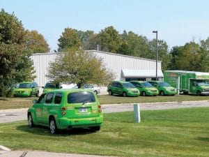 Servpro is a growing business with a sizable fleet of distinctive bright green service vehicles awaiting disaster cleanup calls.