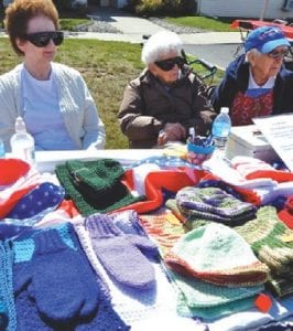 The Sit-and-Stitch Group, a club of resident knitters at Woodhaven senior community, sold and raffled off their wares during the annual Fall Fest celebration.