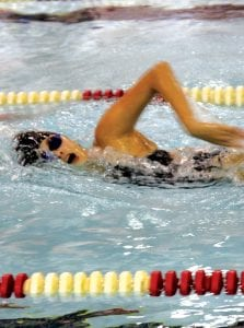 Selena Adams works her way across the pool for the Carman-Ainsworth/Flushing varsity swim and dive team.