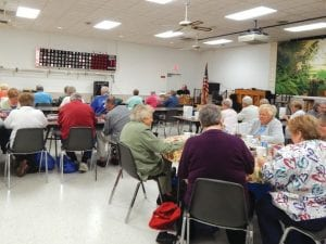 "Seniors play Bingo hoping to win one of many valuable prizes donated by local businesses to the senior center's second annual ""Pig Roast"" fundraiser."