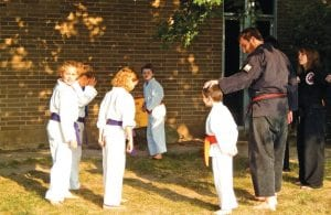 Karate practice was held outside on the lawn at Carman-Ainsworth high school one sunny day.