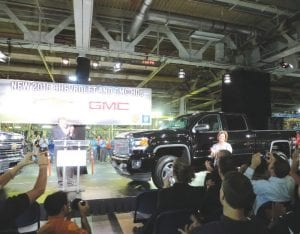 Larry Zahner, GM North America manufacturing manager, (left) and Amy Farmer, Flint Assembly plant manager, unveil the new Chevrolet and Sierra heavy-duty pickups.