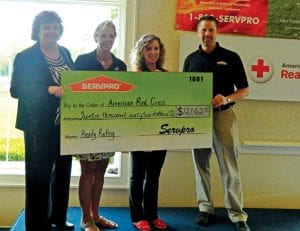 From left: Susan Urban of American Red Cross with SERVPRO representatives Laura Spensley, Laurie Rae and Paul Kerby.