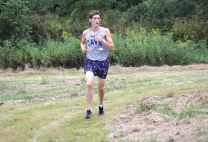 Carman-Ainsworth's Tyler Pangerl rounds a corner on the course.