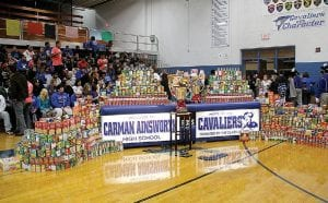 C-A students, staff and supporters piled up a mountain of donations for the Food Bank of Eastern Michigan, shown here during a Spirit Cup pep rally last Friday. Inset, a closer look at the coveted Spirit Cup.