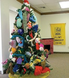 Santa's elves at the Flint Township Hall have been busy all year knitting most of the hats, gloves and scarves used to decorate this mitten tree on display in the township's meeting room. The tree is sponsored by Flint Township's Clerical Union AFSCME Local 1918-01. These gifts of warmth will be donated to children in the Carman-Ainsworth School District who are in need of proper winter clothing. Monetary donations are also being accepted through December 17 for the purchase of more mittens, hats and scarves. Collection boxes also are available in the lobby for non-perishable food items being donated to the Food Bank of Eastern Michigan and new, unwrapped toys to be donated to Toys for Tots.