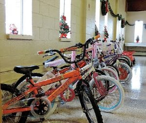 Bikes and other kiddie vehicles lined the aisles at the union hall during the Toys for Tots presentation.