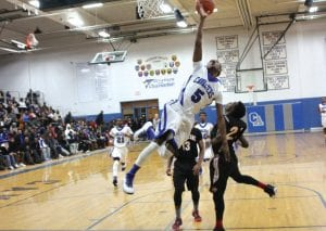 Carman-Ainsworth's Justice Green goes off balance against Grand Blanc Tuesday at home.