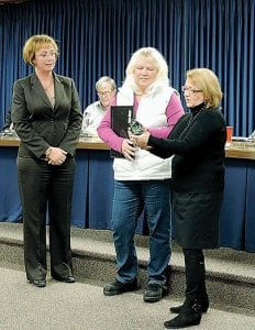 Supervisor Karyn Miller and Clerk Kim Courts present a proclamation and retirement gift to Deb Gorey.