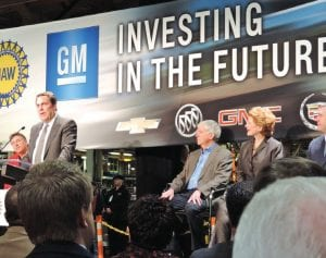 At right, Mark Reuss, president of GM North America, announces a $600 million investment at Flint Assembly on Monday as Gov. Rick Snyder, local politicians and union leaders look on. Left, Gov. Rick Snyder, makes a few remarks at the GM press conference announcing a multi-million investment in Michigan plants including Flint Assembly.