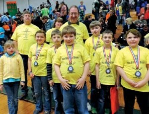 Left, the Banana Bricks, a robotics team based at C-A's Randels Elementary, also were among the 48 teams competing in the state contest. Mo' Peeps, the FLL robotics team based at Carman- Ainsworth Rankin Elementary, shown here with the state championship trophy won in last weekend's tournament.