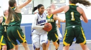 Carman-Ainsworth's Asjia Blanton drives the lane in a game agaainst Lapeer East.