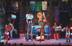 The cast of STOMP during a performance this past year.