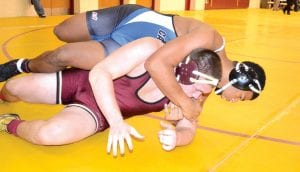 Carman-Ainsworth's Jerron Thomas (top) works over a Davison wrestler in the Dec, 21 County Meet. Thomas went 5-0 in the Warren Woods-Tower Invitational last Saturday.