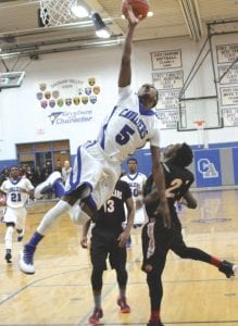 Carman-Ainsworth's Justice Green goes hard to the basket.