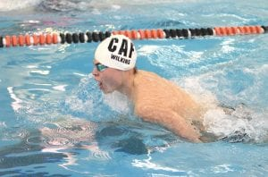 Carman-Ainsworth's Zak Wilkins paces through the breaststroke finals at the County Meet at Fenton last Saturday.