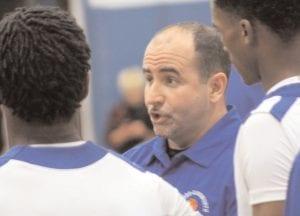 Cavalier's head coach Jay Witham talks to his varsity basketball team.