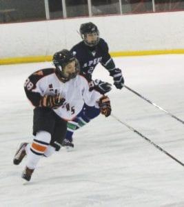 Flushing/Carman-Ainsworth's Brady Hoganson races up ice.