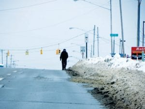 As the snow piles higher and higher, it has to go somewhere. Knee-deep and higher snow on the shoulders of the road leaves no choice to pedestrians like this man who was walking along busy Corunna Road recently with his back to traffic. Please remember for safety's sake, people forced to walk in the street are advised to walk on the left side of the road facing oncoming traffic.